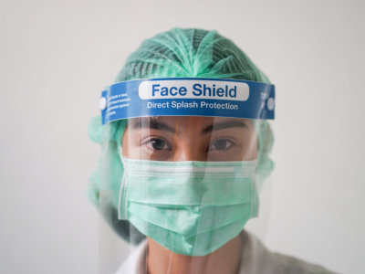 Head shot image of Medical staff wearing Personal Protective Equipment